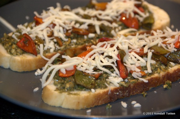 Soon to be Panini: pesto, marinated peppers, and mozzarella