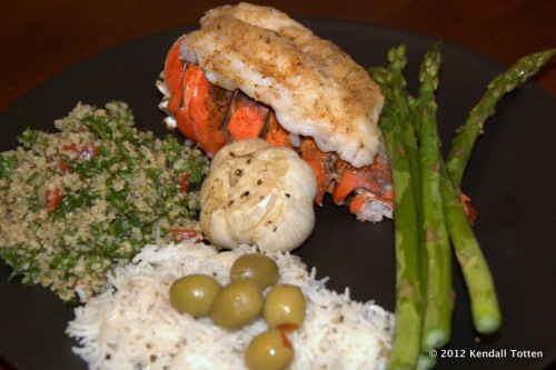 Broiled lobster tail, rice, tabouli, asparagus, roasted garlic.